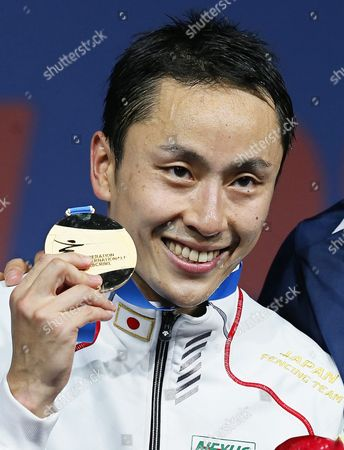 Yuki Ota of Japan Poses with His Gold Medal on the Podium After Beating Alexander Massialas of the Usa in Their Men's Foil Individual Final of the World Fencing Championships in Moscow Russia 16 July 2015 Russian Federation Moscow