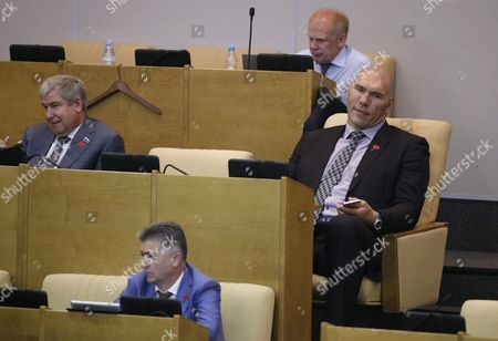 Russian Deputy and Former Heavyweight Boxer Nikolai Valuev (r) Sits in His Chair Before Russian President Vladimir Putin's Speech (not Pictured) During the Last Session For the State Duma on the Completion of Work by the Current Deputies in Moscow Russia 22 June 2016 Russian President Vladimir Putin Has Set the Date of the Elections to the State Duma For 18 September 2016 Russian Federation Moscow
