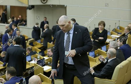 Russian Diver Dmitri Sautin (r) and Former Professional Boxer Nikolai Valuev Gestures Before Russian Prime Minister Dmitry Medvedev (not Pictured) Presents His Report on the Government Work in 2015 at the Russian State Duma in Moscow Russia 19 April 2016 Russian Federation Moscow