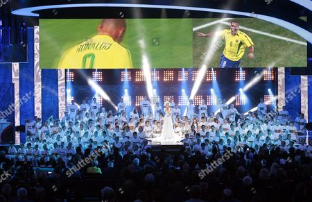 Stock Image of Russian Singer Polina Gagarina (c) Performs in Front of a Children's Chorus During the Preliminary Draw of the Fifa World Cup 2018 at Konstantinovsky Palace Outside St Petersburg Russia 25 July 2015 St Petersburg is One of the Host Cities of the Fifa World Cup 2018 in Russia Which Will Take Place From 14 June Until 15 July 2018 Russian Federation St.petersburg
