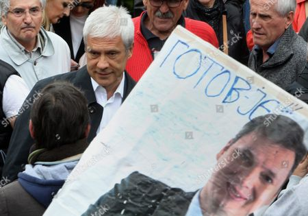 Former Serbian President Boris Tadic (2-l) Talks to Supporters who Hold a Picture of Serbian Prime Minister Aleksandar Vucic Reading in Serbian Cyrillic Letters: 'It is Finished' During a Rally in Belgrade Serbia 30 April 2016 where Thousands of Opposition Supporters Gathered in Front of the Serbian State Electoral Commission Opposition Parties in Serbia United For a Protest Against what They Claim was Vote Rigging in the Country Recent Parliament Elections in Favour of the Center-right Serbian Progressive Party of Prime Minister Aleksandar Vucic Serbia and Montenegro Belgrade