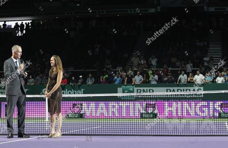 Martina Hingis (2-l) Being Presented with Her Tennis Hall of Fame Ring by Todd Martin (l) Ceo of the International Tennis Hall of Fame During the Bnp Paribas Wta Finals 2015 Held at the Indoor Stadium in Singapore 25 October 2015 Singapore Singapore