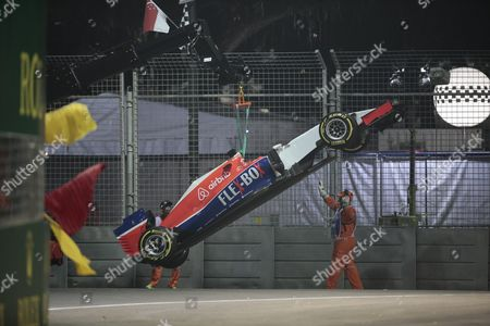 The Car of British Formula One Driver Will Stevens of Manor Marussia F1 Team Being Removed From the Track During the Second Practise Session on the Marina Bay Street Circuit in Singapore 18 September 2015 the Singapore Formula One Grand Prix Night Race Takes Place on 20 September 2015 Singapore Singapore