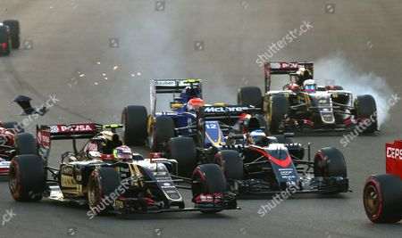 Stock Image of Venezuelan Formula One Driver Pastor Maldonado (front L) of Lotus F1 Team Spanish Formula One Driver Fernando Alonso (front R) of Mclaren Honda Brazilian Formula One Driver Felipe Nasr (back L) of Sauber F1 Team and French Formula One Driver Romain Grosjean (back R) of Lotus F1 Team in Action During the Formula One Grand Prix of Abu Dhabi at Yas Marina Circuit in Abu Dhabi United Arab Emirates 29 November 2015 United Arab Emirates Abu Dhabi