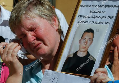 An Ukrainian Woman Cries As She Holds a Portrait of Ukrainian Serviceman who was Captured by Pro-russian Separatists During the Conflict in Eastern-ukrainian and is Still Kept As Prisoners of War During a Rally in Front of the Presidential Office in Kiev Ukraine 08 August 2016 the Protesters Urged the Ukrainian Government to Speed Up the Releasing and Returning of Ukrainian Prisoners of War From Pro-russian Separatists' Captivity the Rally was Organized by Ukrainian Military Pilot and Parliamentarian Nadezhda Savchenko who was Released From a Russian Jail on 25 May 2016 Ukraine Kiev