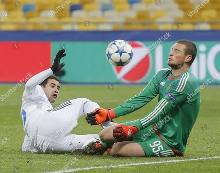 Derlis Gonzalez (l) of Dynamo Vies For the Ball with Predrag Rajkovic (r) Goalkeeper of Maccabi During the Uefa Champions League Group Stage Group G Soccer Match Between Dynamo Kyiv and Maccabi at the Olimpiyskiy Stadium in Kiev Ukraine 09 December 2015 Ukraine Kiev