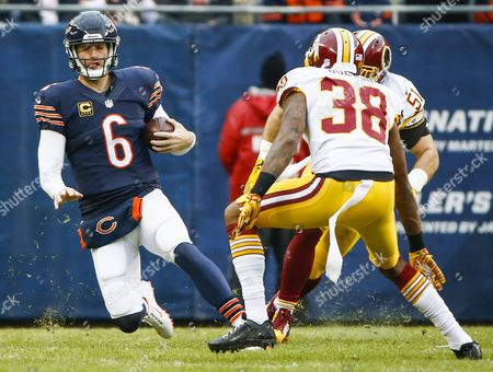 Chicago Bears Quarterback Jay Cutler Slides to the Ground After Gaining Five Yards and a First Down Against Washington Redskins Free Safety Dashon Goldson (c) and Washington Redskins Inside Linebacker Keenan Robinson (r) in the First Half of Their American Football Game at Soldier Field in Chicago Illinois Usa 13 December 2015 United States Chicago