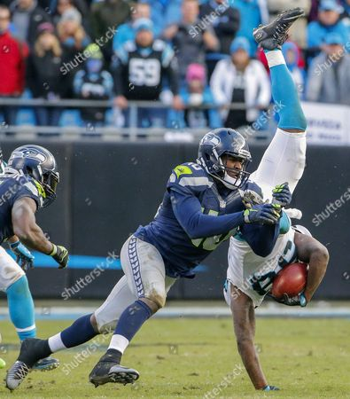 Carolina Panthers Linebacker Thomas Davis (r) Recovers an Onside Kick Against Seattle Seahawks Fullback Derrick Coleman (l) During the Second Half of Their Nfl American Football Nfc Divisional Playoff Game at Bank of America Stadium in Charlotte North Carolina Usa 17 January 2016 the Panthers Defeated the Seahawks and Will Host the Arizona Cardinals in the Nfc Championship Game United States Charlotte