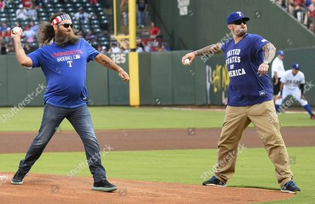 Duck Dynasty Tv Show Star Willie Robertson (l) Along with Navy Seal Marcus Luttrell (r) Throw out the First Pitch Before the New York Yankees Game Against the Texas Rangers at Globe Life Park in Arlington Texas Usa 27 July 2015 United States Arlington