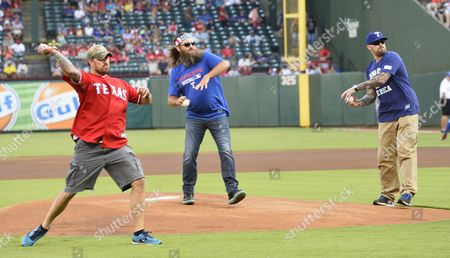 Duck Dynasty Tv Show Star Willie Robertson (c) Along with Navy Seals Marcus Luttrell (r) and His Brother Morgan Luttrell (l) Throw out the First Pitch Before the New York Yankees Game Against the Texas Rangers at Globe Life Park in Arlington Texas Usa 27 July 2015 United States Arlington