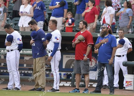 Duck Dynasty Tv Show Star Willie Robertson (r) Walks Onto the Field with Navy Seals Marcus Luttrell (l) and His Brother Morgan Luttrell (c) Along with Texas Rangers Players Stand For the National Anthem Before the New York Yankees Game Against the Texas Rangers at Globe Life Park in Arlington Texas Usa 27 July 2015 United States Arlington