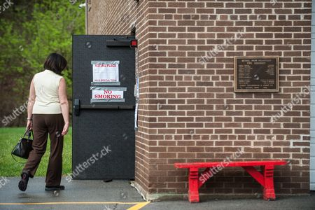 A Woman Arrives to Vote at the Clifton Fire Station in Bethel Park Pennsylvania Outside of Pittsburgh Pennsylvania Usa 26 April 2016 Hillary Clinton and Bernie Sanders Are Battling For the Democratic Nomination While Donald Trump Ted Cruz and John Kasich Compete For the Republican Nomination United States Bethel Park