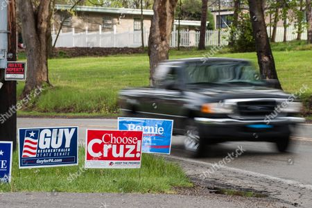 A Truck Drives Past a Group of Signs Outside of the Clifton Fire Station in Bethel Park Pennsylvania Outside of Pittsburgh Pennsylvania Usa 26 April 2016 Hillary Clinton and Bernie Sanders Are Battling For the Democratic Nomination While Donald Trump Ted Cruz and John Kasich Compete For the Republican Nomination United States Bethel Park