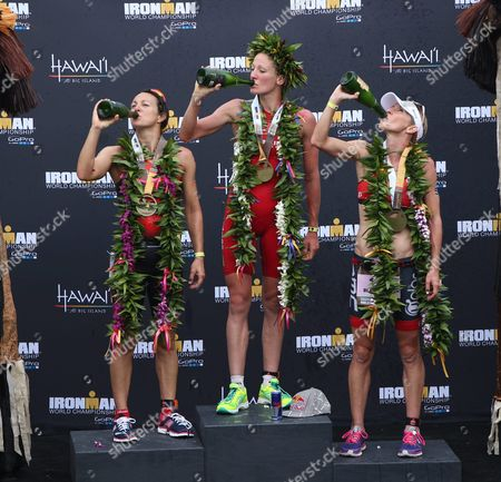 The Top Three Women's Finishers (l-r) Rachel Joyce (2nd Place) of the Uk Daniela Ryf (first) of Switzerland and Liz Blatchford (third) of Australia Celebrate with Champagne on the Podium of the 2015 Ironman World Championship in Kailua-kona Hawaii Usa 10 October 2015 the Culmination of a Series of International Ironman Races on the World Championship Course the Athletes Compete in a 3 85 Km Swim Then a 180 Km Bike Ride to Finish It Off with a 42 195 Km Marathon Run United States Kailua-kona
