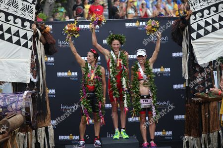 The Top Three Women's Finishers (l-r) Rachel Joyce (2nd Place) of the Uk Daniela Ryf (first) of Switzerland and Liz Blatchford (third) of Australia Celebrate on the Podium of the 2015 Ironman World Championship in Kailua-kona Hawaii Usa 10 October 2015 the Culmination of a Series of International Ironman Races on the World Championship Course the Athletes Compete in a 3 85 Km Swim Then a 180 Km Bike Ride to Finish It Off with a 42 195 Km Marathon Run United States Kailua-kona