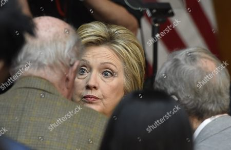 Democratic Presidential Candidate and Former Secretary of State Hillary Clinton (c) Talks with Former Secretary of State George Shultz (l) and Former Secretary of Defense William Perry (r) After Delivering a Speech on Counterterrorism to Guest at Stanford Universtiy in Stanford California Usa 23 March 2016 United States Stanford