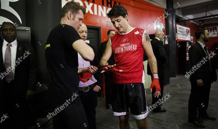 Canadian Prime Minister Justin Trudeau (c) Gets His Hands Wrapped by Yuri Foreman (l) For a Work out at Gleason's Gym in Brooklyn New York Usa 21 April 2016 Trudeau is in New York to Participate in the Formal Signing of the Paris Climate Agreement on 22 April at the United Nations United States Brooklyn