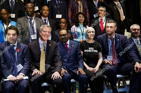In the Front Row (l-r) Patrick Klugman the Deputy Mayor of Paris Bill De Blasio the Mayor of New York City Michel Sidibe Unaids Executive Director Scottish Musician Annie Lennox and Vitali Klitschko (r) the Mayor of Kiev Ukraine Pose with Others For a Picture at the Start of the Event 'Fast-track Cities: Ending the Aids Epidemic' at the New York Public Library in New York New York Usa on 06 June 2016 Mayors From a Number of Cities Attended to Discuss Progress Toward the Group's Goals of Stopping the Aids Epidemic Around the World United States New York