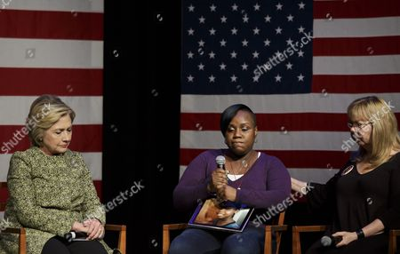 Democratic Presidential Candidate Hillary Clinton (l) and Sandy Phillips (r) Listen As Natasha Christopher (c) Talks About Losing Her Son to a Shooting During a Discussion About Gun Violence Prevention at the Landmark Theater in Port Washington New York Usa 11 April 2016 Joining Them on Stage Were Three Other Women who Have Lost Family Members to Gun Violence New York Will Hold Its Primary Election on 19 April 2016 United States Port Washington