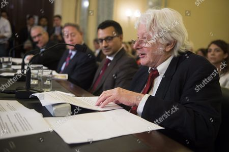 Stock Photo of Investigative Writer and Filmmaker Andrew Jennings (r) Testifies During the Senate Commerce Science and Transportation Committee's Hearing Entitled 'Examining the Governance and Integrity of International Soccer' on Capitol Hill in Washington Dc Usa 15 July 2015 United States Washington