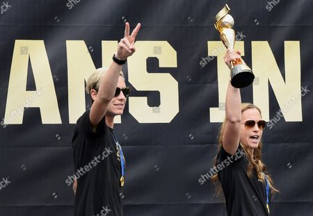 Us Women's National Soccer Team Defender Christie Rampone (r) Hoists the Trophy Next to Forward Abby Wambach (l) As They Celebrate with Fans During a Rally For the Team in Downtown Los Angeles California Usa 07 July 2015 the Us Team Were Honored at the Rally by Some 10 000 Fans After Winning the Fifa Women's World Cup 2015 Final Between the Usa and Japan in Vancouver Canada on 05 July 2015 United States Los Angeles