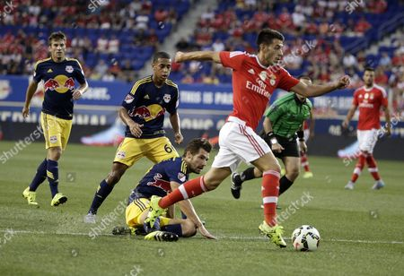 Sl Benfica Midfielder Pizzi #21 (r) Pushes the Ball Past New York Red Bulls New York Red Bulls Defender Damien Perrinelle #55 (bottom) During Their Game Their International Champions Cup Match at Red Bulls Arena in Harrison New Jersey Usa 26 July 2015 United States Harrison