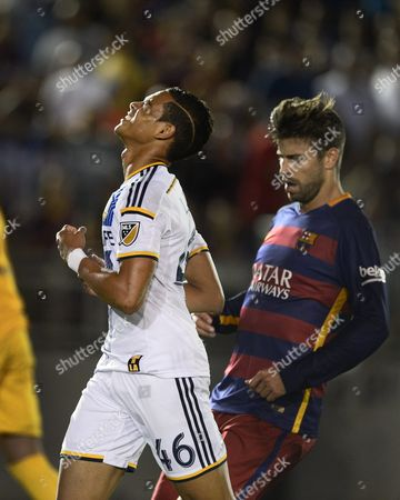La Galaxy's Ariel Lassiter (l) Reacts After Missing a Shot with Fc Barcelona Gerard Pique (r) Defending in the Second Half of Their International Champions Cup Soccer Match at the Rose Bowl in Pasadena California Usa 21 July 2015 Lassiter Missed the Shot and the Galaxy Lost 2-1 United States Pasadena