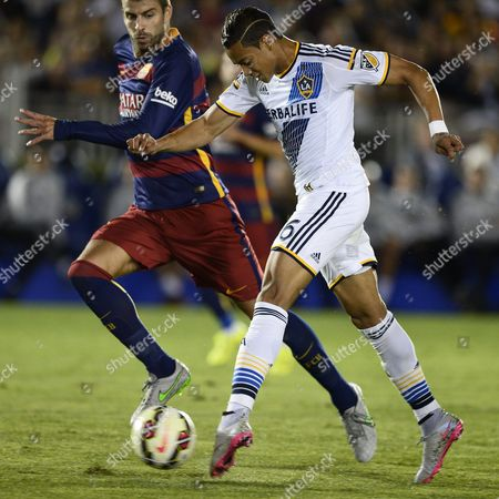La Galaxy's Ariel Lassiter (r) Takes a Shot As Fc Barcelona's Gerard Pique (l) Defends in the Second Half of Their International Champions Cup Soccer Match at the Rose Bowl in Pasadena California Usa 21 July 2015 Lassiter Missed the Shot and the Galaxy Lost 2-1 United States Pasadena