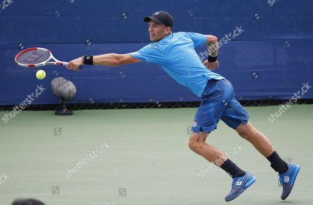 Jarkko Nieminen of Finland Hits a Return to Jo-wilfried Tsonga of France During Their Match on the First Day of the 2015 Us Open Tennis Championship at the Usta National Tennis Center in Flushing Meadows New York Usa 31 August 2015 the Us Open Runs Through 13 September Which is a Return to a 14-day Schedule United States Flushing Meadows