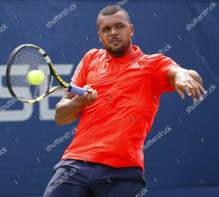 Jo-wilfried Tsonga of France Hits a Return to Jarkko Nieminen of Finland During Their Match on the First Day of the 2015 Us Open Tennis Championship at the Usta National Tennis Center in Flushing Meadows New York Usa 31 August 2015 the Us Open Runs Through 13 September Which is a Return to a 14-day Schedule United States Flushing Meadows