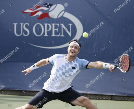 Michael Berrer of Germany Hits a Return to Tommy Robredo of Spain During Their Match on the First Day of the 2015 Us Open Tennis Championship at the Usta National Tennis Center in Flushing Meadows New York Usa 31 August 2015 the Us Open Runs Through 13 September Which is a Return to a 14-day Schedule United States Flushing Meadows