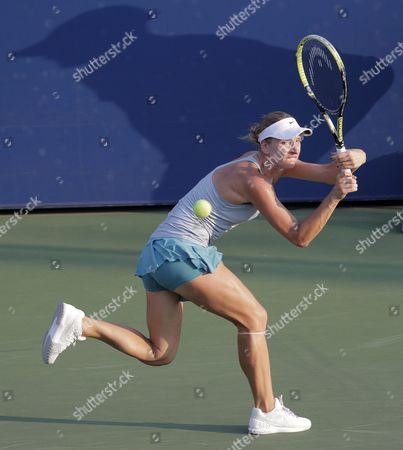 Stock Photo of Sesil Karatantcheva of Bulgaria Hits a Return to Belinda Bencic of Switzerland During Their Match on the First Day of the 2015 Us Open Tennis Championship at the Usta National Tennis Center in Flushing Meadows New York Usa 31 August 2015 the Us Open Runs Through 13 September Which is a Return to a 14-day Schedule United States Flushing Meadows