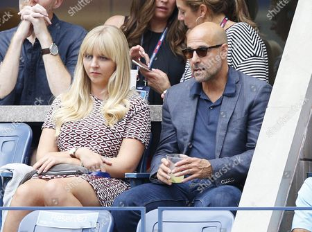 Us Actor Stanley Tucci (r) Watches Flavia Pennetta of Italy and Roberta Vinci of Italy Play in the Women's Final on the Thirteenth Day of the 2015 Us Open Tennis Championship at the Usta National Tennis Center in Flushing Meadows New York Usa 12 September 2015 the Us Open Runs Through 13 September Which is a Return to a 14-day Schedule United States Flushing Meadows