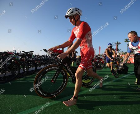 Ben Hoffman of the Usa Races Through the Transition Area to Begin the Biking Leg of the Ironman World Championship in Kailua-kona Hawaii Usa 10 October 2015 the Culmination of a Series of International Ironman Races in the World Championship Course the Athletes Compete in a 3 85 Km Swim Then a 180 Km Bike Ride to Finish It Off with a 42 195 Km Marathon Run United States Kailua-kona