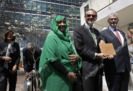 Jan Eliasson Deputy Secretary- General of the United Nations (c) Holds a Commemorative Plaque at a Tree Planting Ceremony in the Un Food Garden Between Amira Gornass (l) Chairperson of World Food Security and Mogens Lykketoft (r) President of the General Assembly on the Occasion of Earth Day and the Signing of the Paris Agreement on Climate Change at the United Nations Headquarters in New York New York Usa 22 April 2016 the Paris Agreement was Adopted in Paris France on 12 December 2015 to Limit Global Temperature Rise to Well Below 2 Degrees Celsius United States New York