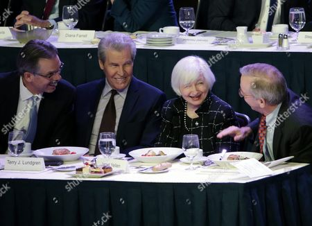 Stock Photo of William Dudley Chair of the Economic Club of New York (r) Chats with Chair of the Federal Reserve Janet Yellen (c) Terry Lundgren President and Ceo of Macy's (2-l) and Glenn H Hutchins Vice Chair of the Economic Club of New York (l) During the Economic Club of New York Luncheon in Midtown Manhattan in New York New York Usa 29 March 2016 United States New York