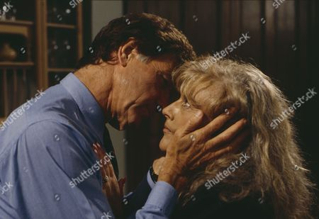 Norman Bowler (as Frank Tate) and Coral Atkins (as Ruth Jamieson) share a passionate embrace as Zoe arrives home (Ep 1806 - 7th October 1993)