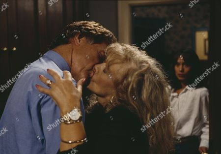 Norman Bowler (as Frank Tate) and Coral Atkins (as Ruth Jamieson) share a passionate embrace as Zoe arrives home, with Leah Bracknell (as Zoe Tate) (Ep 1806 - 7th October 1993)