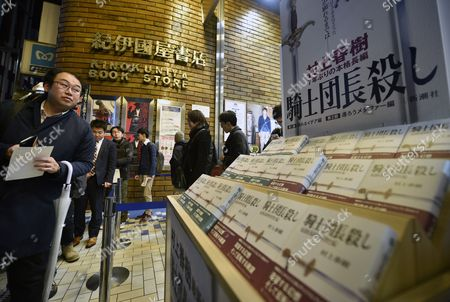 Fans of Japanese best-selling author Haruki Murakami line up next to a display of the new book 'Kishidancho Goroshi' or 'Killing Commendatore' at Kinokuniya bookstore in Shinjuku district, Tokyo, Japan, just after midnight on 24 February 2017. The new book by Murakami is published in two parts. Publisher printed 700,000 copies of the first part and 600,000 of the second.