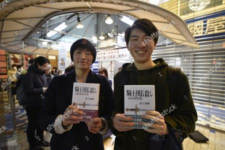 Shingo Kawamorita (L) and Masahiro Inoue (R) hold copies of Japanese best-selling author Haruki Murakami new book 'Kishidancho Goroshi' or 'Killing Commendatore' they just purchased at Kinokuniya bookstore in Shinjuku district, Tokyo, Japan, just after midnight on 24 February 2017. The new book by Murakami is published in two parts. Publisher printed 700,000 copies of the first part and 600,000 of the second.