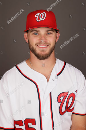 Washington Nationals' Nick Lee poses for a photograph before a spring training baseball workout, in West Palm Beach, Fla