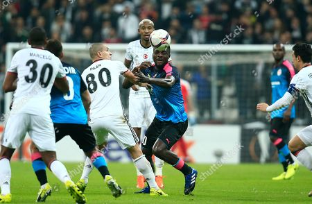 Besiktas' Gokhan Inler, left, tries to stop Hapoel Beer-Sheva's John Ugu, centre, during a Europa League round of 32 second leg soccer match between Besiktas and Hapoel Beer-Sheva in Istanbul