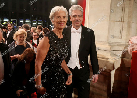 Christine Lagarde, Hans Joerg Schelling The Director of the International Monetary Fund (IMF), Christine Lagarde and Austrian Finance Minister Hans Joerg Schelling, from left, arrive for the traditional Opera Ball in front of the state opera in Vienna, Austria