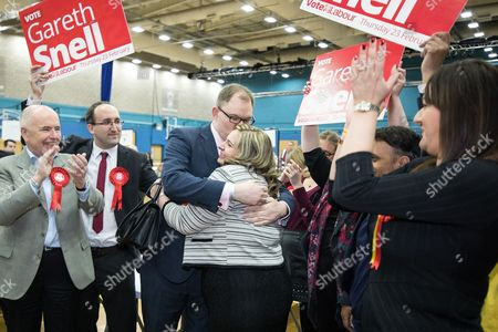 Gareth Snell hugs wife Sophia Snell as he is declared the winner at the count in the by-election for the constituency of Stoke-on-Trent Central