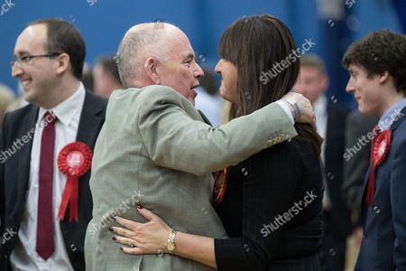 Jack Dromey and Ruth Smeeth hug at the count in the by-election for the constituency of Stoke-on-Trent Central