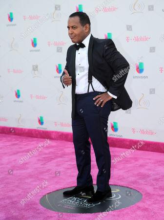 Tony Dandrades poses on the red carpet before the Premio Lo Nuestro Latin Music Awards, in Miami