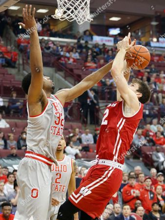 Ethan Happ, Thompson Wisconsin's Ethan Happ, right, tries to shoot over Ohio State's Trevor Thompson during the first half of an NCAA college basketball game, in Columbus, Ohio