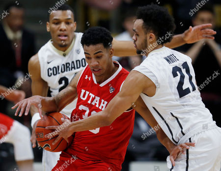 Gabe Bealer, George King, Derrick White Utah guard Gabe Bealer, center, loses control of the ball as Colorado guard George King, back, and guard Derrick White defend during the second half of an NCAA college basketball game late, in Boulder, Colo