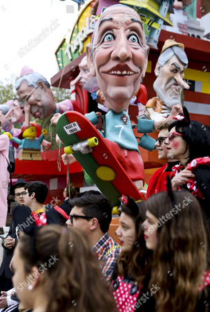 Stock Photo of Big head toys representing Portugal's President Marcelo Rebelo de Sousa (C), the former President, Anibal Cavaco Silva (R), and the Prime Minister, Antonio Costa (L) are seen during the children's carnival parade in Torres Vedras, Portugal, 24 February 2017. The Carnival of Torres Vedras features several parades with the children's parade featuring elementary and middle school students wearing masks or costumes they have made themselves.