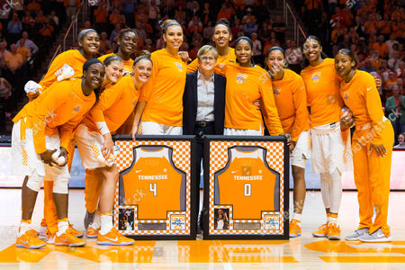 Tennessee Lady Volunteers seniors Schaquilla Nunn #4 and Jordan Reynolds #0 are recognized with head coach Holly Warlick and the rest of the team before the NCAA basketball game between the University of Tennessee Lady Volunteers and the University of Florida Gators at Thompson Boling Arena in Knoxville TN Tim Gangloff/CSM